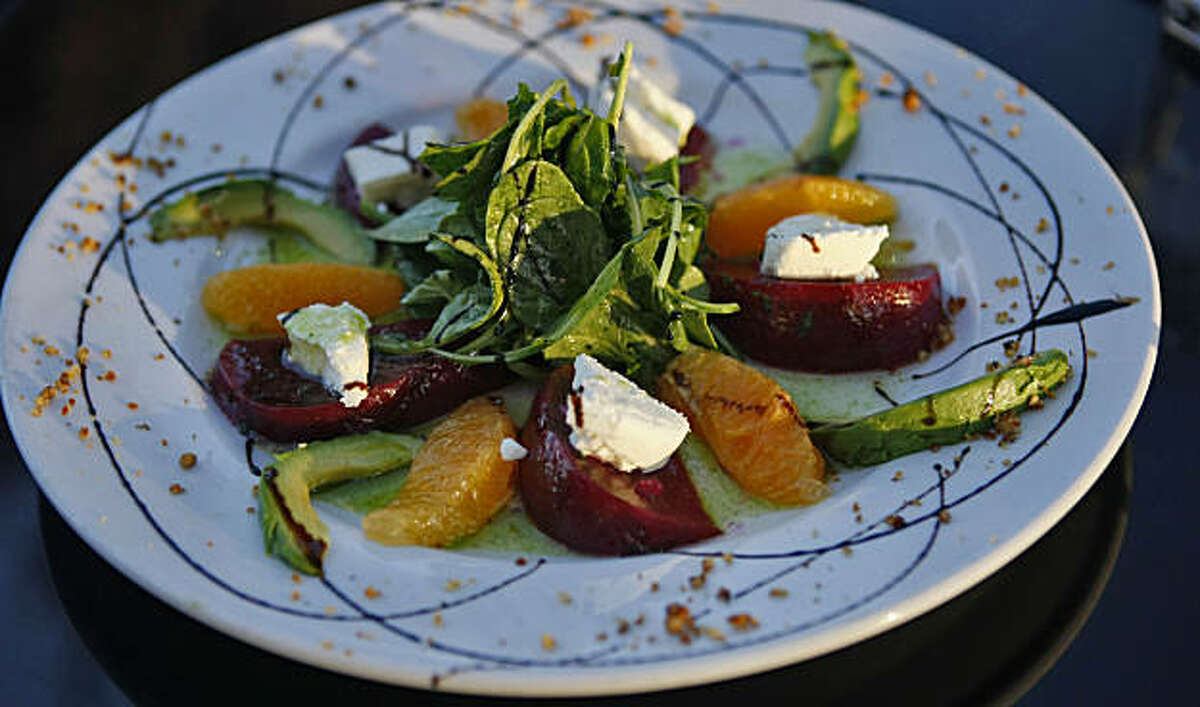 Customers enjoy the roasted beet salad, Tuesday August 25, 2009, at the Bella Ristorante in Concord, Calif.
