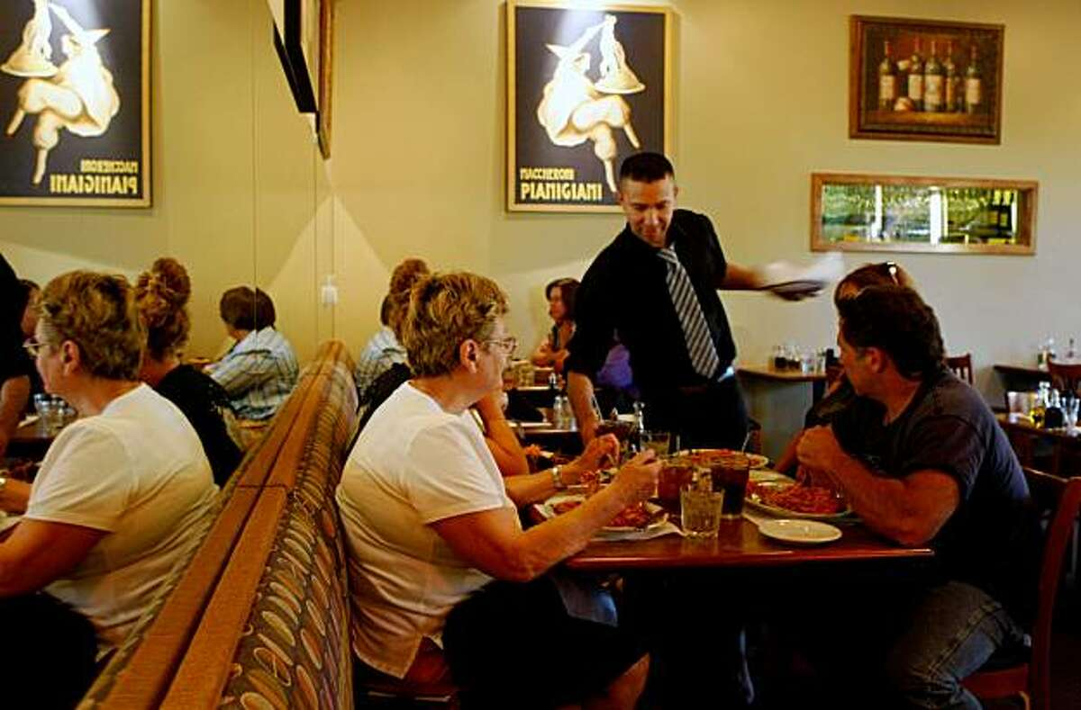 Customers enjoy dinner, Tuesday August 25, 2009, at the Bella Ristorante in Concord, Calif.