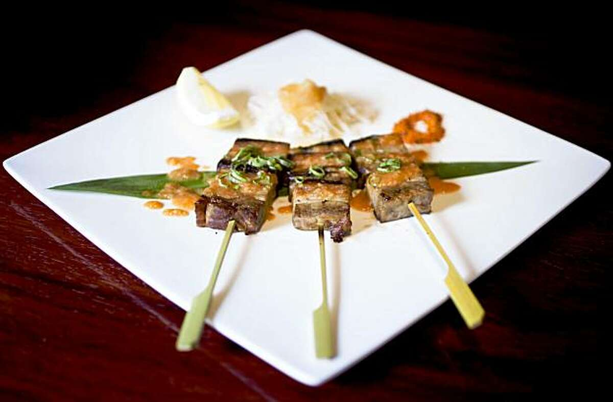 Buta, or Kurobuta pork belly skewers with spicy miso served at Ozumo in Oakland, Calif. on Monday, Aug. 10, 2009.