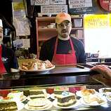 Juan Alvarado and Sam Katzman (right) tend to customers during the lunch time rush at Tommy's Joynt  in San Francisco, Calif., on Tuesday, July 29, 2009.  Tommy's serves their food hof-brau style, which is somewhat like a cafeteria.