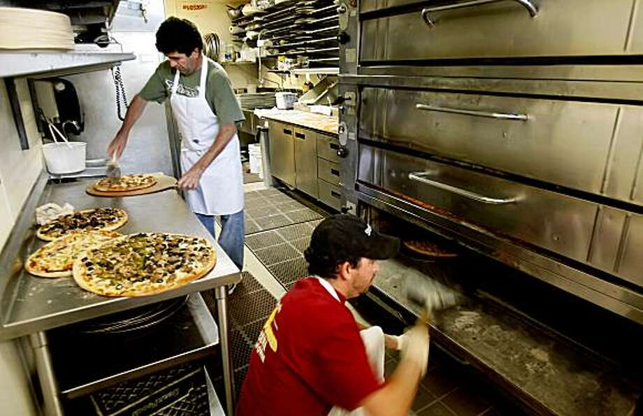 Pizza in slices and whole pies fly out of the kitchen area at Stefano's. Stefano's Pizzeria claims to be the only solar powered pizza restaurant around. Located at 11 East Blithedale in downtown Mill Valley. Photo: Brant Ward, The Chronicle