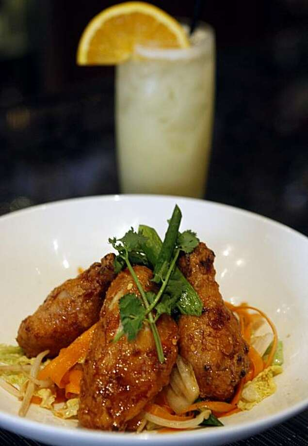 Hot pepper chicken wings are served with an orange Ramos fizz  in the bar of LB Steak restaurant at Santana Row in San Jose, Calif., on Wednesday, July 15, 2009. Photo: Paul Chinn, The Chronicle