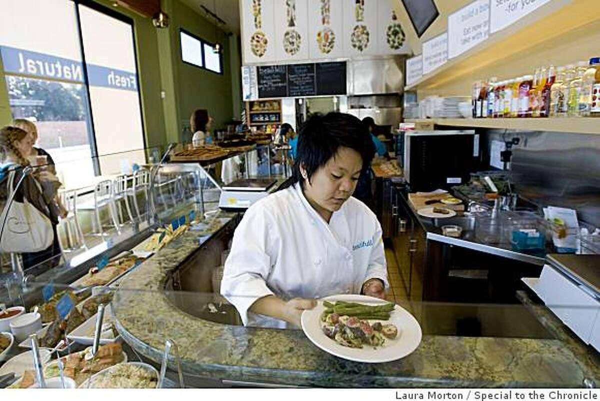 M.J. Ladringan prepares a dish at Beautiful, a Laurel Village restaurant that serves fresh, healthy food in San Francisco, Calif., on Saturday, June 20, 2009.