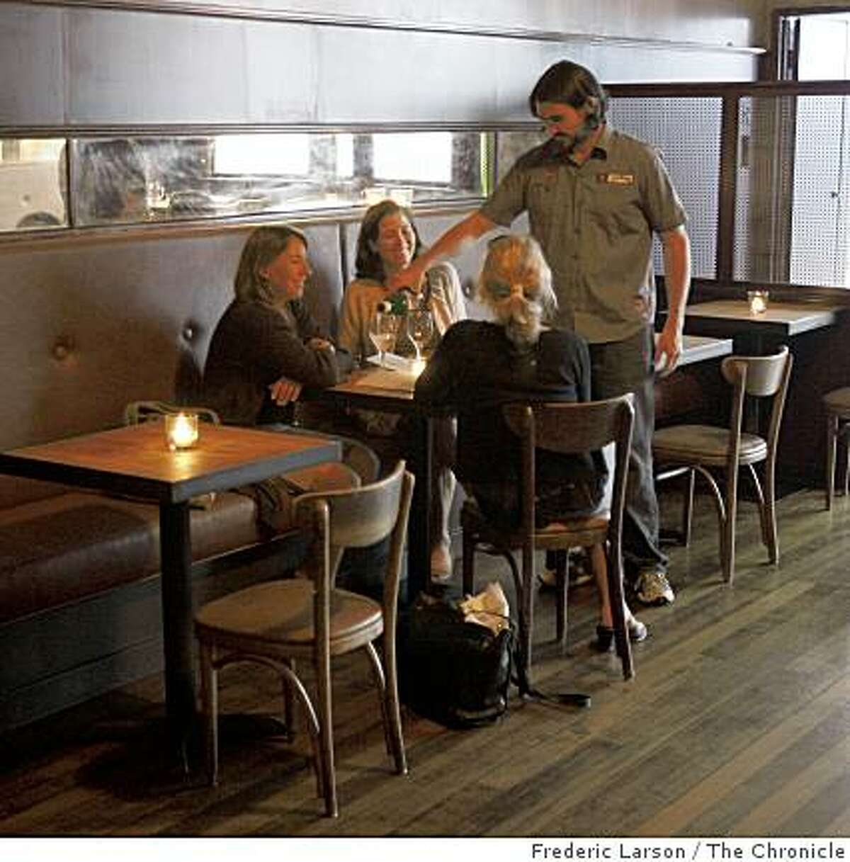 Bar restaurant 15 Romolo is located off Broadway in San Francisco has a main dinning room opened to the bar where people eat and drink.