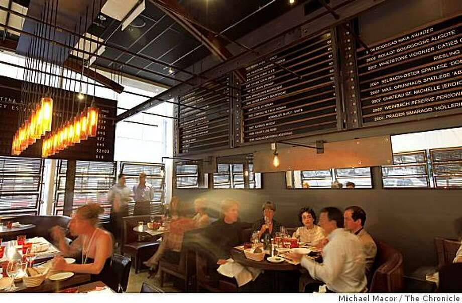 "The wine list covers the entire back wall of the dinning room of the new Michael Mina restaurant, ""RN74"" in San Francisco, Calif., on Tuesday April 21,2009.The establishment is located in on the street level of the  Millenium Towers at 301 Mission St. Photo: Michael Macor, The Chronicle"