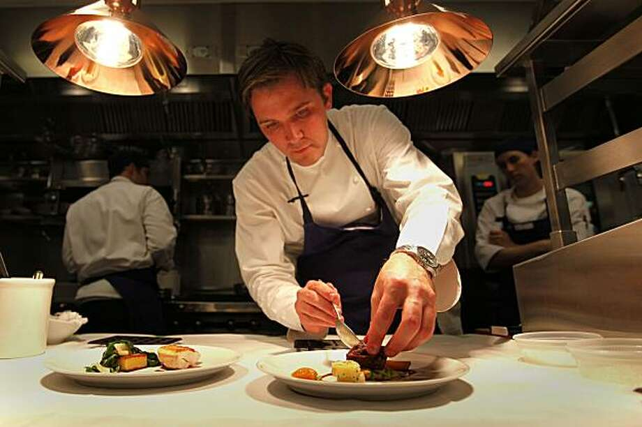 "Executive Chef, Jason Berthold prepares at the new Michael Mina restaurant, ""RN74"", in San Francisco, Calif., on Tuesday April 21,2009. The restaurant is located on the street level of the Millenium Towers at 301 Mission St. Photo: Michael Macor, The Chronicle"