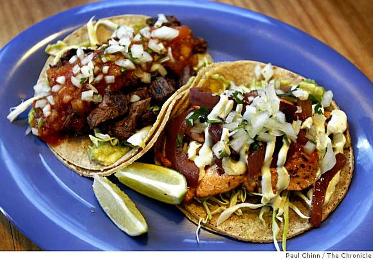 Carne asada (left) and salmon tacos are served at Little Chihuahua taqueria in San Francisco, Calif., on Tuesday, April 14, 2009.