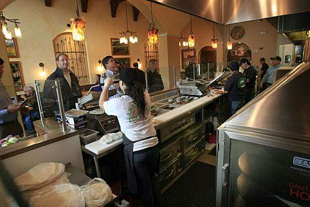 Sonoma Latina Grill has a cafeteria-style line for ordering and features tortillas (handmade), flatbread tacos, garden salad with grilled nopalitos, chorizo fundido on April 7, 2009. Ran on: 04-16-2009 Patrons line up at the cafeteria- style counter of Sonoma Latina Grill. At left, grilled nopalitos turn a green salad into a delight, crunching with radish, red onion, celery, pepitas and nopales vinaigrette ($6.95). Ran on: 04-16-2009 Patrons line up at the cafeteria- style counter of Sonoma Latina Grill. At left, grilled nopalitos turn a green salad into a delight, crunching with radish, red onion, celery, pepitas and nopales vinaigrette ($6.95). Photo: Frederic Larson, The Chronicle