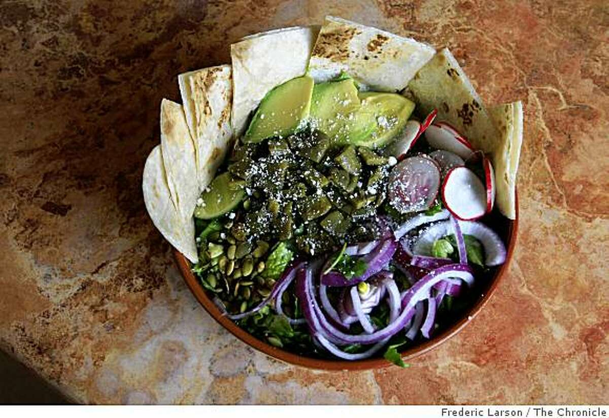 Sonoma Latina Grill has a cafeteria-style line for ordering and features tortillas (handmade) a dish called Garden Salad with Grilled Nopalitos on April 7, 2009.