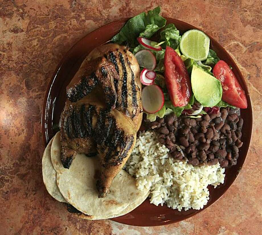 Sonoma Latina Grill has a cafeteria-style line for ordering and features tortillas (handmade) and a dish called Wood Fired Polla Asado which has a half chicken, beans, cilantro rice and a house salad on April 7, 2009. Photo: Frederic Larson, The Chronicle