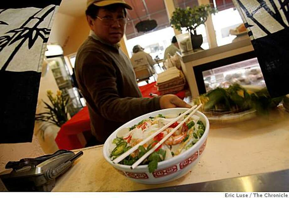 David Huynh, owner Linda Lam's father, picks up an order of Seafood Noodle Soup dish at  the Little Vietnam Cafe in San Francisco  photographed on Friday, February 27, 2009. Photo: Eric Luse, The Chronicle