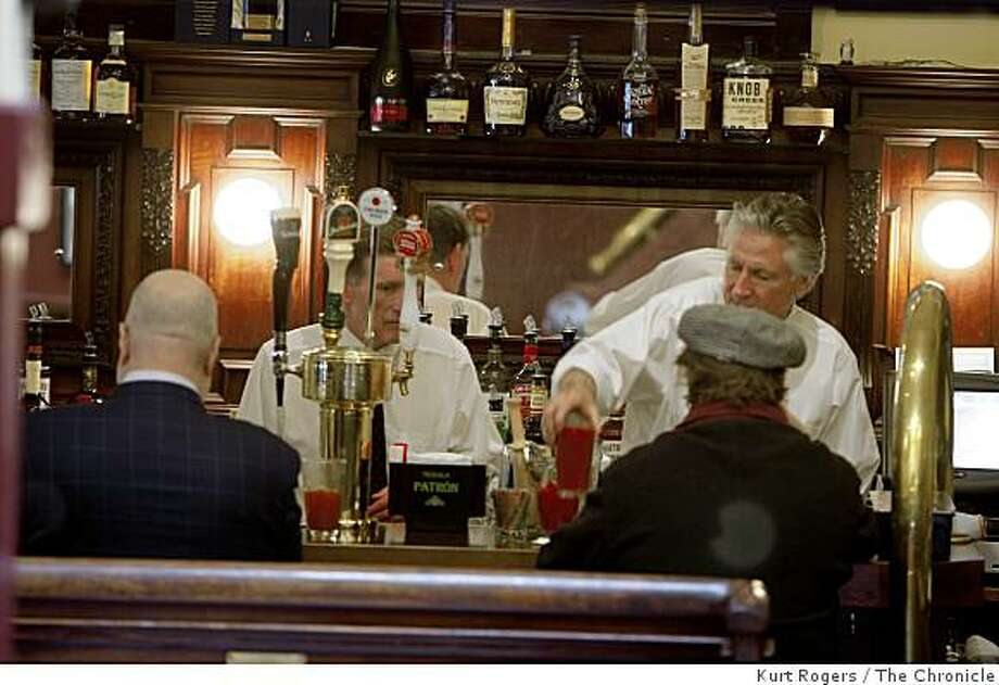 Bar tenders Mitch Galbreath (Left) and Michael Frasier serve some of the first customers back to the Washington Square Bar and Grill after it's reopening.on Tuesday  Mar 3,  2009 in San Francisco, Calif Photo: Kurt Rogers, The Chronicle