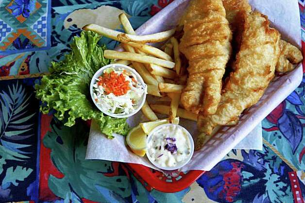 Fish and Chips is one of the favorite dishes served at the Flying Fish Grill in Half Moon Bay, Calif. on January 6, 2009. Ran on: 01-15-2009 The Flying Fish Grill in Half Moon Bay, above, may not have an ocean view, but it offers fresh seafood choices such as fish and chips, below. Photo: Michael Maloney, The Chronicle