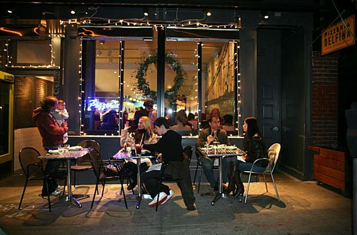 Diners enjoy their meal outside at Pizzeria Delfina in San Francisco, Calif. on Sunday, December 28, 2008.