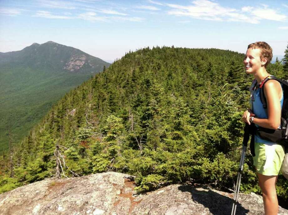 Avery Forbes stands on Mount Bigelow in Maine. The mountain is part of the 2,081-mile Appalachian Trail, which Forbes hiked this year. Photo: Contributed Photo / Westport News