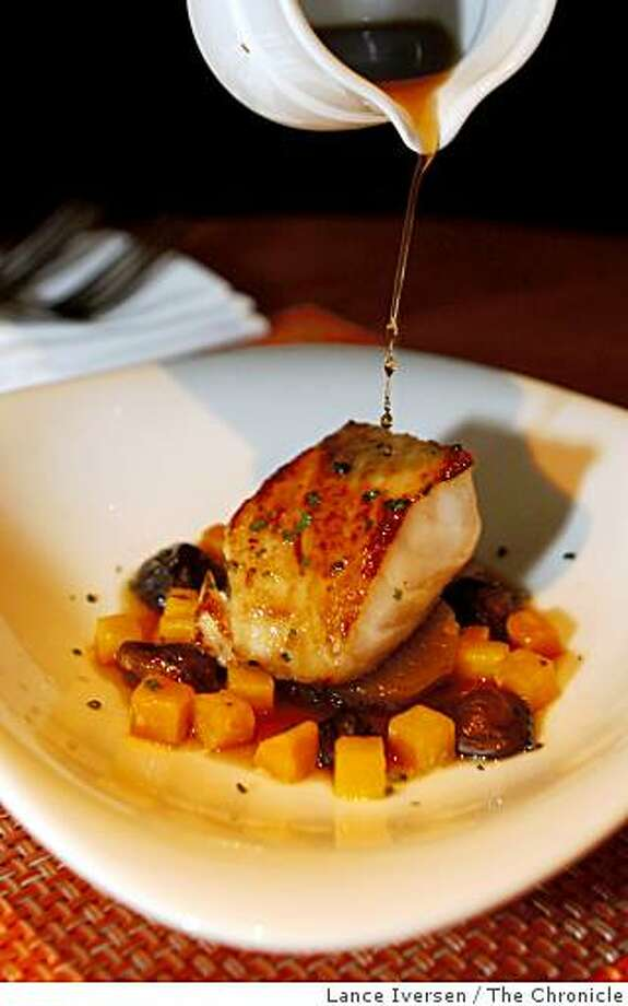 Dashi sauce is poured over Roasted black cod at Zinnia a new restaurant on Jackson Street next to San Francisco�s financial district offers an upscale menu by Chef Sean O' Brien. Friday Dec 19, 2008. Photo: Lance Iversen, The Chronicle
