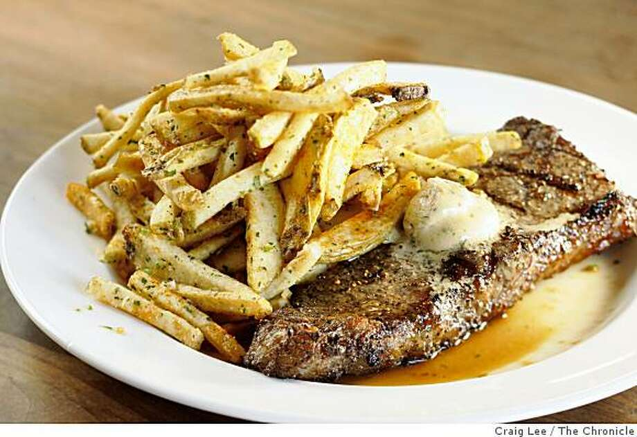 Grilled Niman New York Steak with Manischewitz wine butter and Lemongrass Fries made by Chef Eddie Blyden at Henry's in the Hotel Durant, in Berkeley, Calif., on December 9, 2008. Photo: Craig Lee, The Chronicle