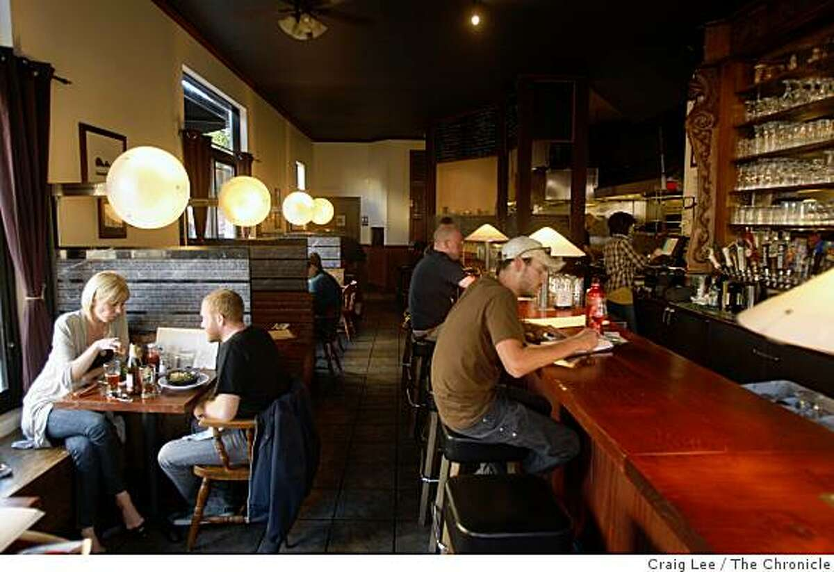 Seth Shukovsky and Janice Arnold seated at the table (left) and Mike Musgrove (right) at the bar at Monk's Kettle, a restaurant and brew pub in San Francisco, Calif., on September 29, 2008.