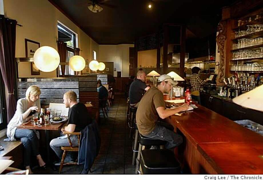 Seth Shukovsky and Janice Arnold seated at the table (left) and Mike Musgrove (right) at the bar at Monk's Kettle, a restaurant and brew pub  in San Francisco, Calif., on September 29, 2008. Photo: Craig Lee, The Chronicle