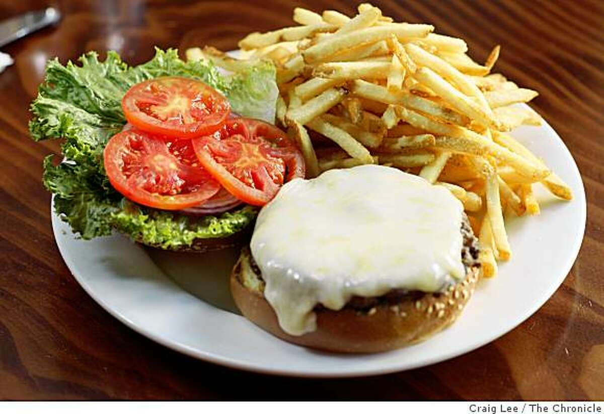 Cheese burger with french fries at Monk's Kettle, a restaurant and brew pub in San Francisco, Calif., on September 29, 2008.
