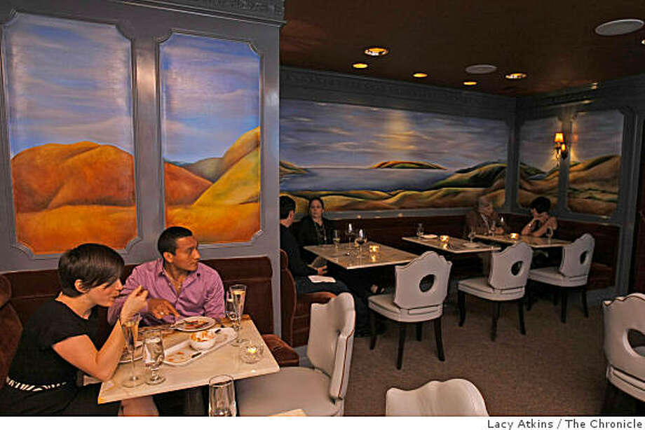 People enjoy themselves in the dinning room at the Leclub restaurant, Wednesday Sept. 24, 2008, in San Francisco, Calif. Photo: Lacy Atkins, The Chronicle