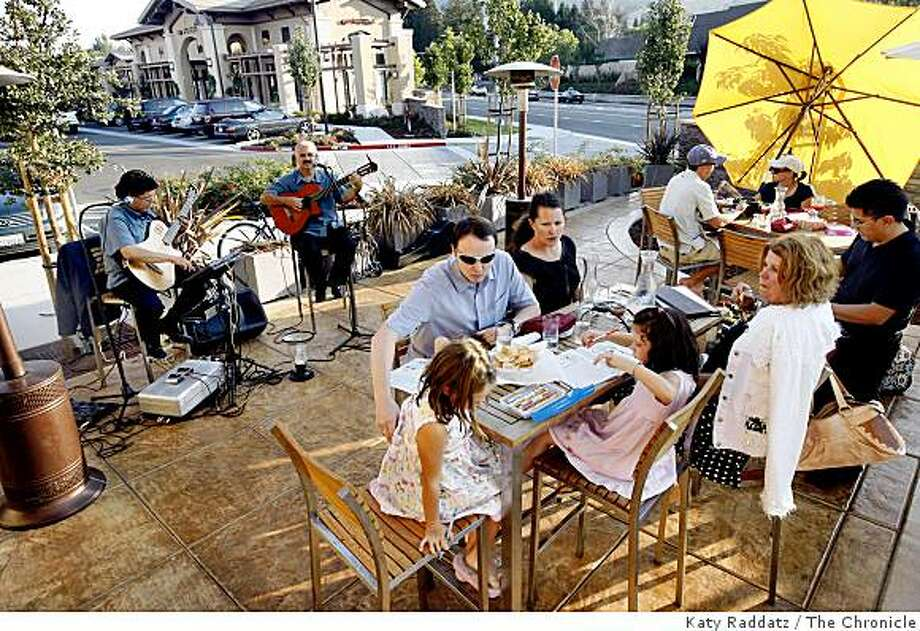 The outdoor patio late on a Sunday afternoon, with guitar players providing extra ambiance, at Amaranta, a Mexican restaurant in the Rose Garden shopping center in Danville, Calif. on  Sunday Sept. 14, 2008 Photo: Katy Raddatz, The Chronicle