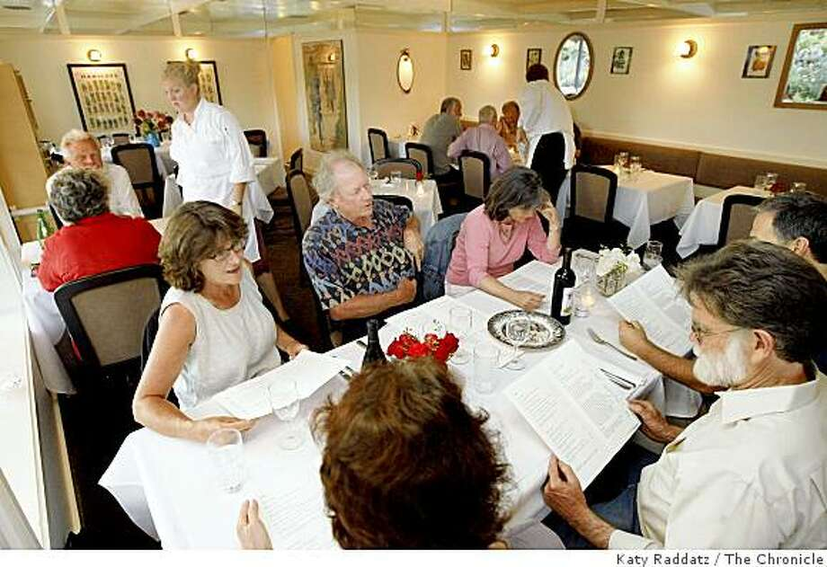 In the main dining room chef/owner Ginevra Iverson, back right, talks with her parents, at Eloise, a restaurant in Sebastopol, Calif. on Thursday, Sept. 4, 2008. Photo: Katy Raddatz, The Chronicle