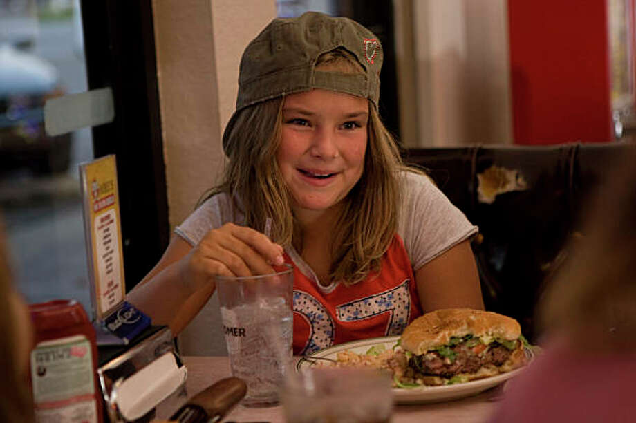 Loren Heins,10, couldn't finish her Nauvoo Burger (Blue Cheese) at Mike's at the Crossroads in Cotati famous for their burgers photographed on Monday, September 8, 2008. Photo: Eric Luse, The Chronicle / SFC