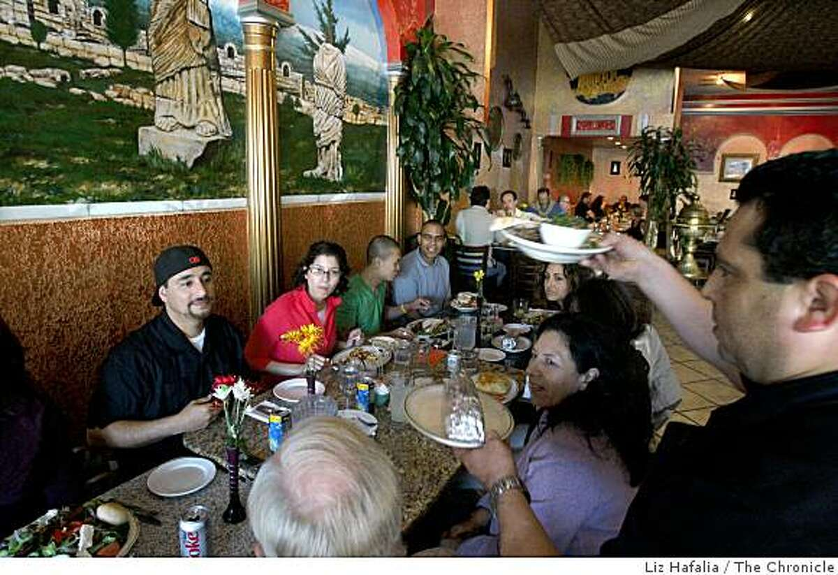 Manager Alejandro Vilchez (back, left) in charge of strengthening neighborhoods for the Peninsula Conflict Resolution Center has a going away party with his co-workers at Sinbad Restaurant and Grill in San Mateo, Calif., on Friday, August 8, 2008.