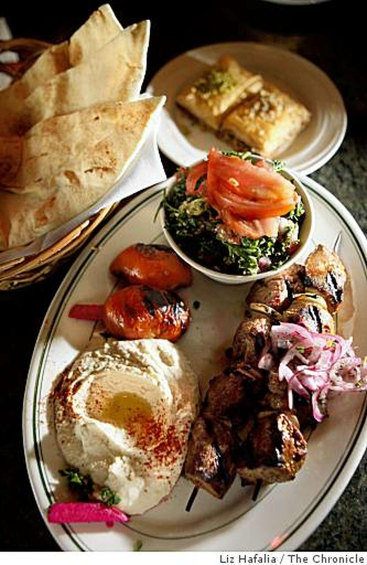 Hummus, lamb shish kebob, tabouli, and baklava at Sinbad Restaurant and Grill in San Mateo, Calif., on Friday, August 8, 2008.