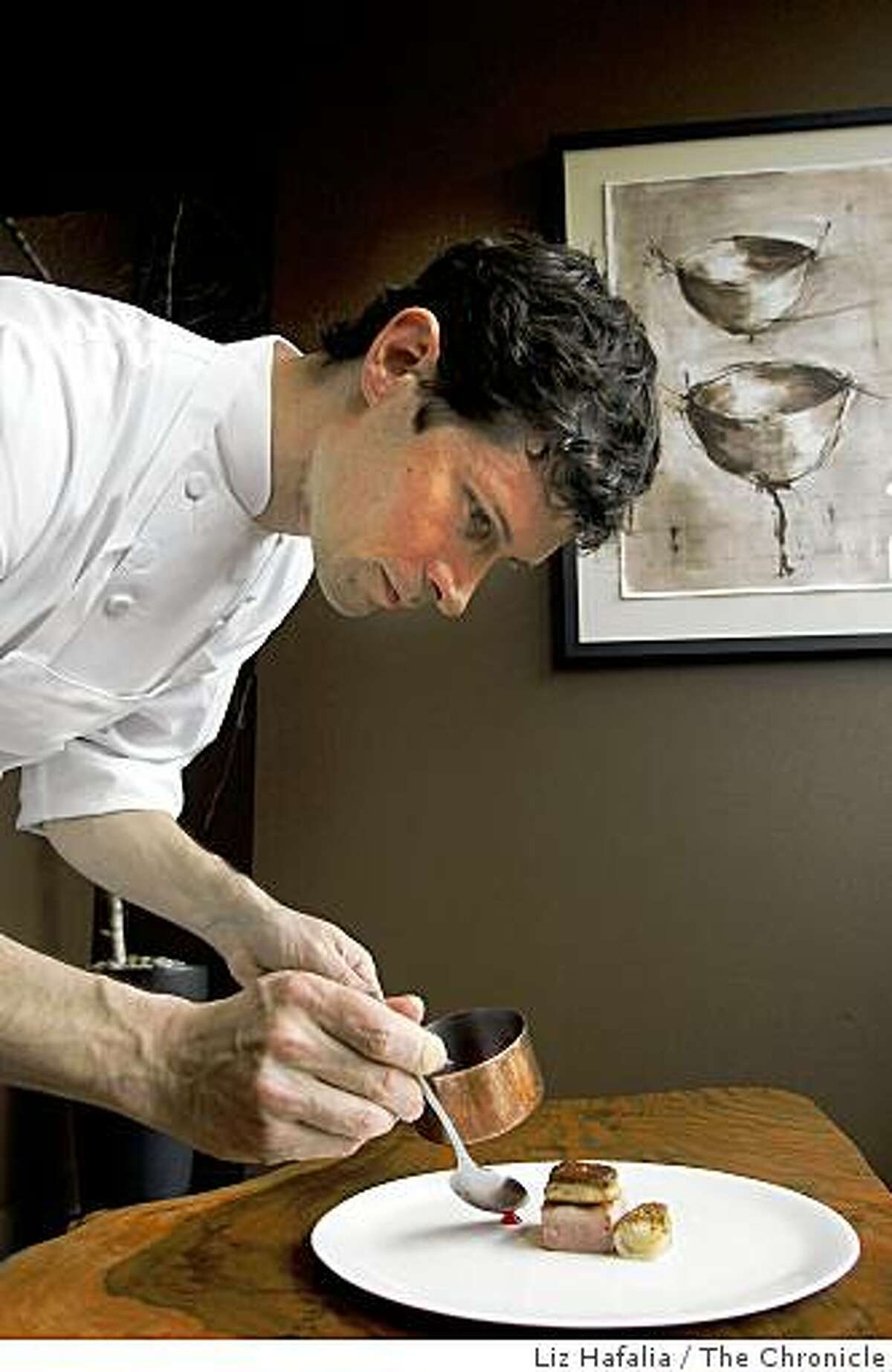 Chef Daniel Patterson of Coi plates his duck breast cooked sous-vide style in foie gras fat, with sauteed foie gras and hibiscus sauce.
