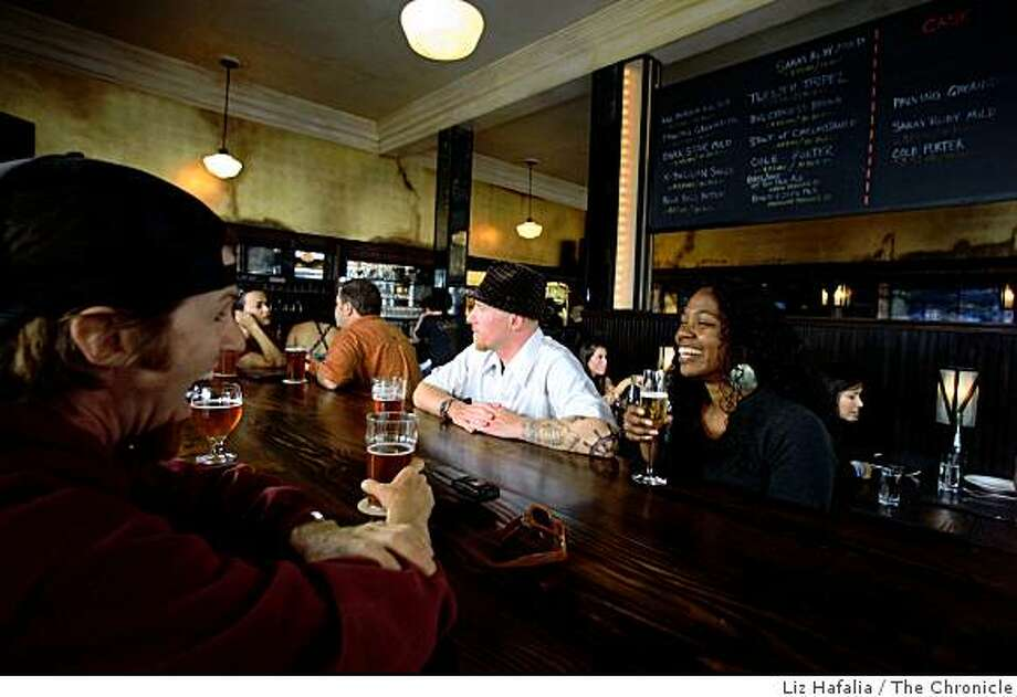 Seth Muir (left), Steve Meyers (middle) and Teresa Hodges (right) at the communal table having beer at Magnolia Pub in San Francisco, Calif., on Thursday, July 24, 2008. Photo by Liz Hafalia/The Chronicle Photo: Liz Hafalia, The Chronicle