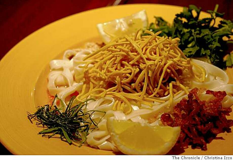The New Burmese restaurant, Mingabala, offers a House Special Noodle dish with flat noodles, coconut chicken, lime leaves, yellow pea's powder, onion, and fried thin noodles. Entr?es from the new Burmese restaurant, Mingabala on Wednesday, July 2, 2008, Burlingame, Calif. Photo by Christina Izzo / The Chronicle Photo: Christina Izzo, The Chronicle