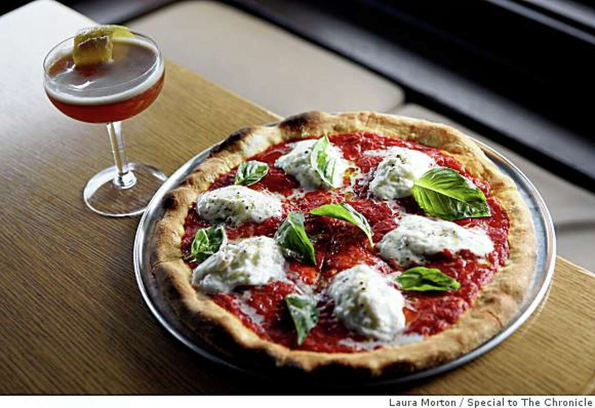 Pizza and the rattlesnake cocktail at Beretta, a Mission District restaurant that serves great pizza and artisan cocktails, in San Francisco, Calif., on Saturday, June 14, 2008.