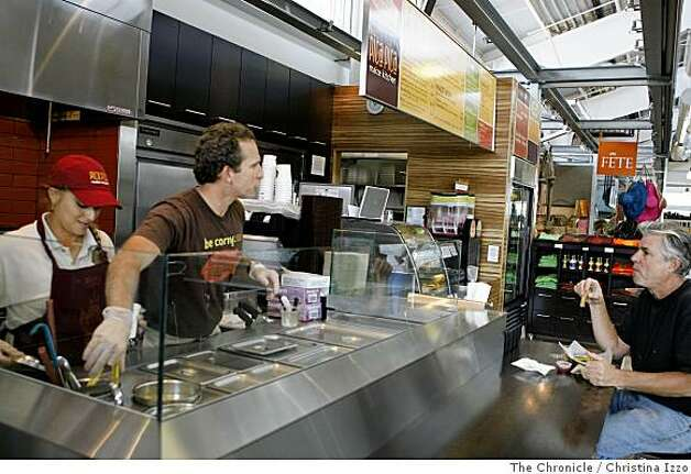 Luis Sosa, general manager, second from left, chats with a customer. The Pica Pica Maize Kitchen in the Oxbow Public Market on Monday, June 23, 2008, Nappa, Calif. Photo By Christina Izzo/ The Chronicle Photo: Christina Izzo, The Chronicle