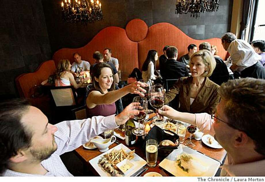 Seth Spalding, Barbara Gnos, Lisa Flynn and Brian Flynn (left to right) raise a glass while dining at Chez Papa Resto, a new restaurant in the Mint Plaza, in San Francisco, Calif., on Friday, May 30, 2008. Photo: Laura Morton, The Chronicle
