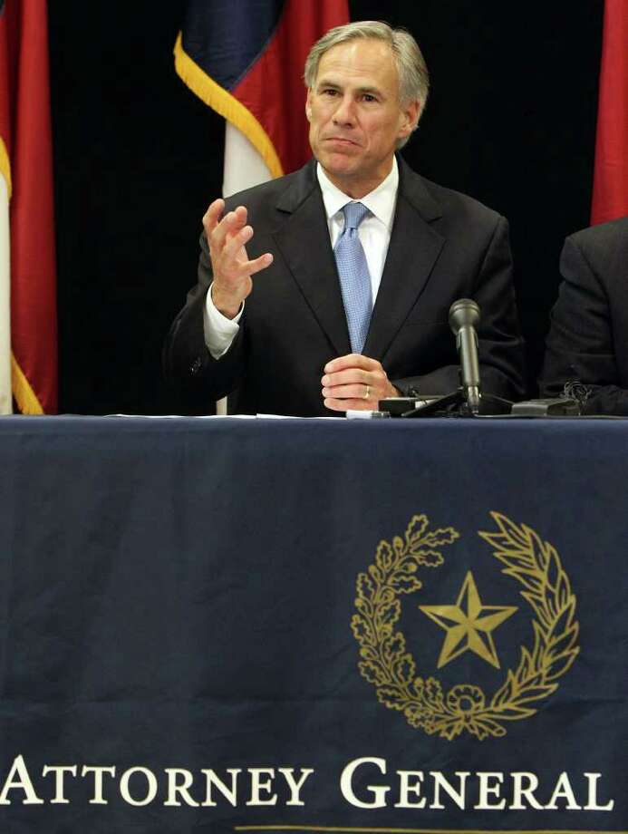 Experts say Attorney General Greg Abbott's use of states' rights offensives will serve him with his deep conservative base. Photo: SAN ANTONIO EXPRESS-NEWS