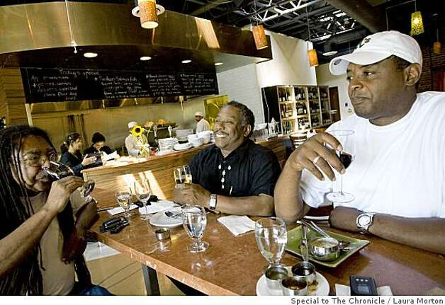 Fred Smith, Darinxoso Oyamasela and Gerald Thomas (left to right) enjoy a glass of wine at Mint Leaf, an Indian bistro and wine bar in Berkeley, Calif., on Saturday, June 14, 2008. Photo: Laura Morton, Special To The Chronicle