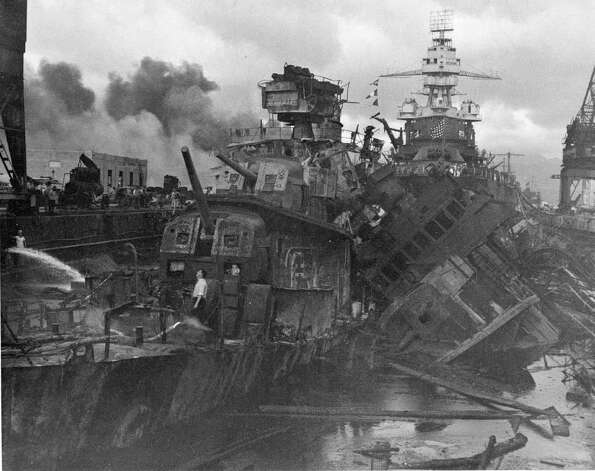 This Dec. 1941 file photo shows heavy damage to ships stationed at Pearl Harbor after the Japanese attack on the Hawaiian island on Dec. 7, 1941. Photo: AP