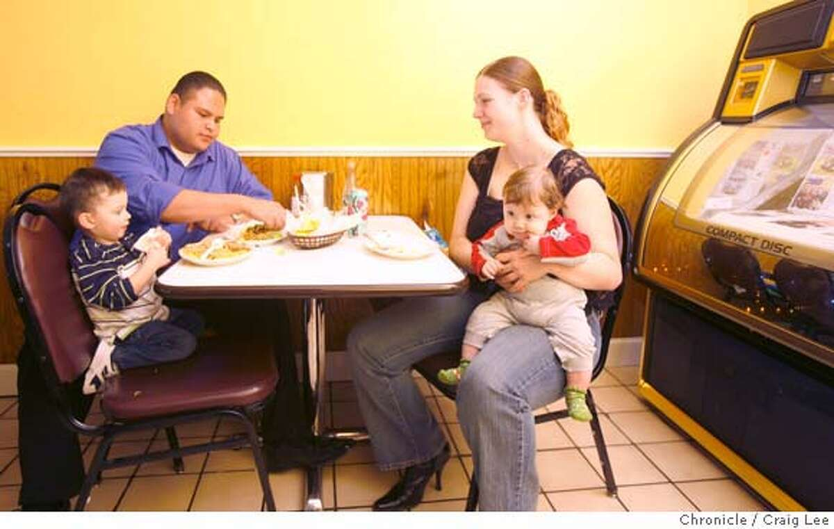 Diego Depaz (left) and his wife, Tiffany Depaz (right), with their two children, Daniel Depaz (left), 2, and david Depaz (right), 4 months-old at Taqueria El Sombrero restaurant in Healdsburg, Calif., on April 7, 2008. They are from Santa Rosa, Calif. Photo by Craig Lee / The