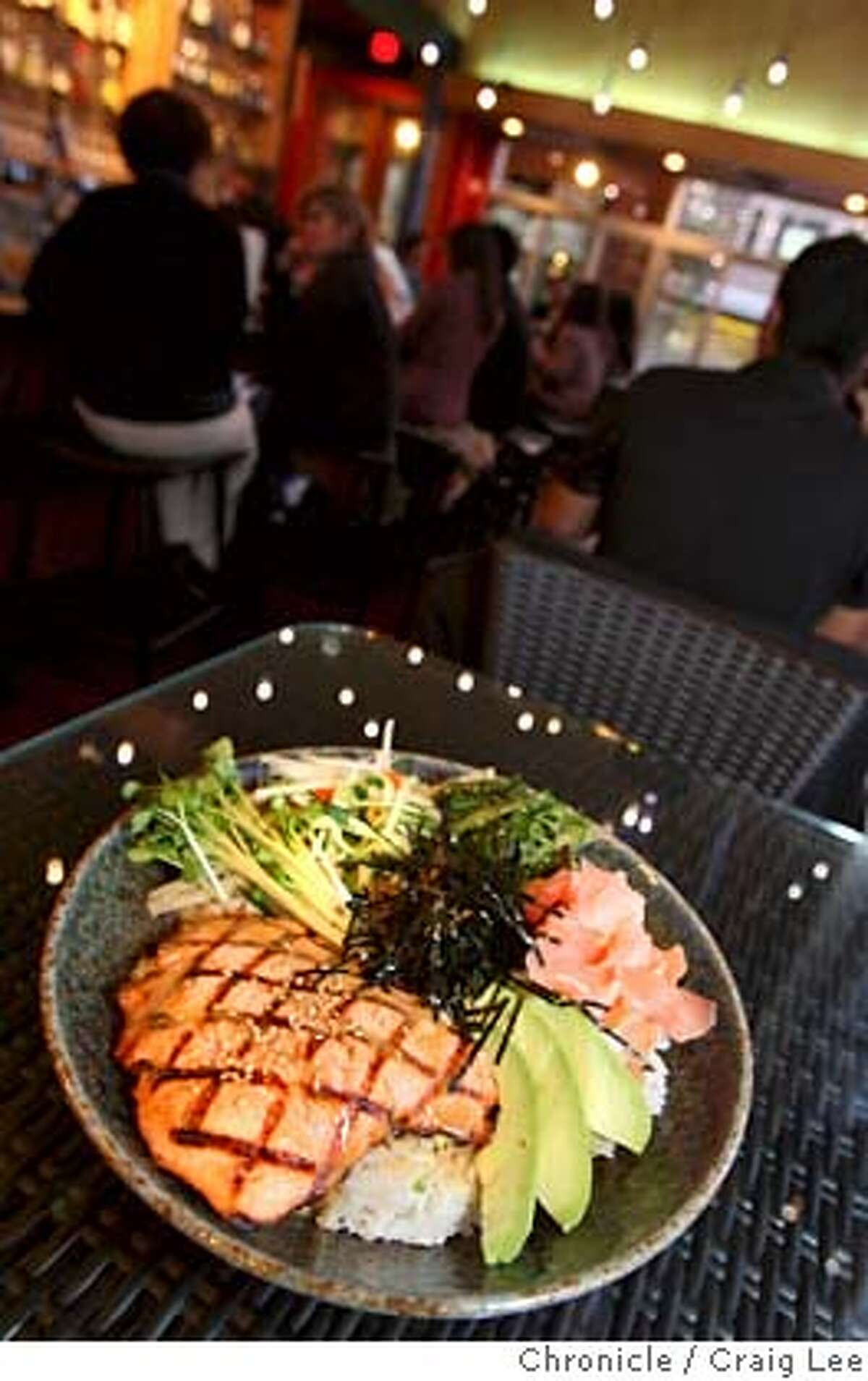 ###Live Caption:A salmon wasabi rice bowl is photographed in the bar area of the restaurant. Pacific Catch is located at 1200 Ninth Ave. in San Francisco. Photo by Brant Ward / San Francisco Chronicle###Caption History:A salmon wasabi rice bowl is photographed in the bar area of the restaurant. Pacific Catch is located at 1200 Ninth Ave. in San Francisco. Photo by Brant Ward / San Francisco Chronicle###Notes:###Special Instructions: