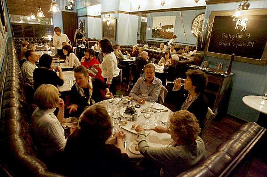 The main dining room at Fish&Farm, a restaurant in San Francisco, Calif. that only uses products obtained within a hundred mile radius of San Francisco, on Wednesday, Feb. 27, 2008. Photo by Katy Raddatz / The Chronicle Photo: KATY RADDATZ, SFC