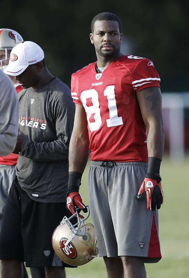 San Francisco 49ers wide receiver Braylon Edwards watches a drill during NFL football training camp Thursday, Aug. 4, 2011, in Santa Clara, Calif. (AP Photo/Paul Sakuma)  Ran on: 08-11-2011 49ers receiver Braylon Edwards was schooled in the Michigan way. Ran on: 08-11-2011 49ers receiver Braylon Edwards was schooled in the Michigan way.  Ran on: 10-29-2011 Braylon Edwards' return will be a game-time decision. Ran on: 10-29-2011 Braylon Edwards' return will be a game-time decision. Photo: Paul Sakuma, AP