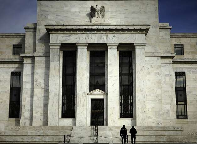 Security guards stand outside the U.S. Federal Reserve building in Washington, D.C., U.S., on Thursday, Dec. 4, 2008. The Federal Reserve drained $25 billion in temporary reserves from the banking system when it arranged overnight reverse repurchase agreements, or repos. Photographer: Brendan Smialowski/Bloomberg News Security guards stand outside the U.S. Federal Reserve building in Washington, D.C., U.S., on Thursday, Dec. 4, 2008. The Federal Reserve drained $25 billion in temporary reserves from the banking system when it arranged overnight reverse repurchase agreements, or repos. Photographer: Brendan Smialowski/Bloomberg News Photo: Brendan Smialowski, Bloomberg News