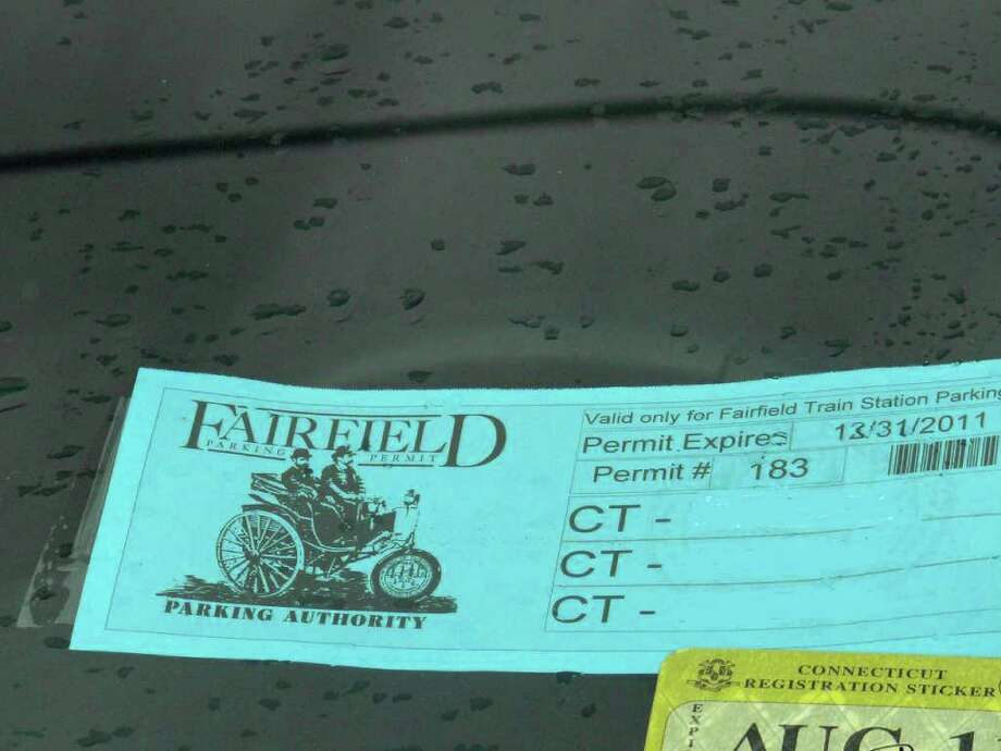 The bright blue train station parking permits will expire Monday when the new Fairfield Metro train station opens. Photo: Genevieve Reilly / Fairfield Citizen