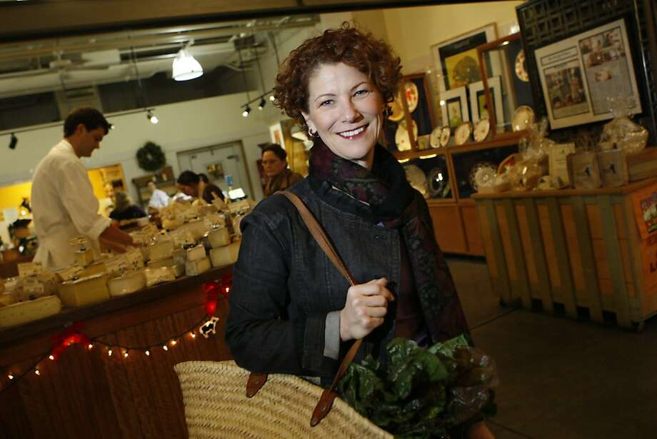 PBS cooking show host Joanne Weir is photographed at the Cowgirl Creamery in the Ferry Building for an On The Town profile in San Francisco, Calif. on Monday, December 1, 2008. Ran on: 12-14-2008 Joanne Weir, PBS cooking show host, looks over the tasty offerings in the Cowgirl Creamery at San Francisco's Ferry Building. Photo: Lea Suzuki, The Chronicle
