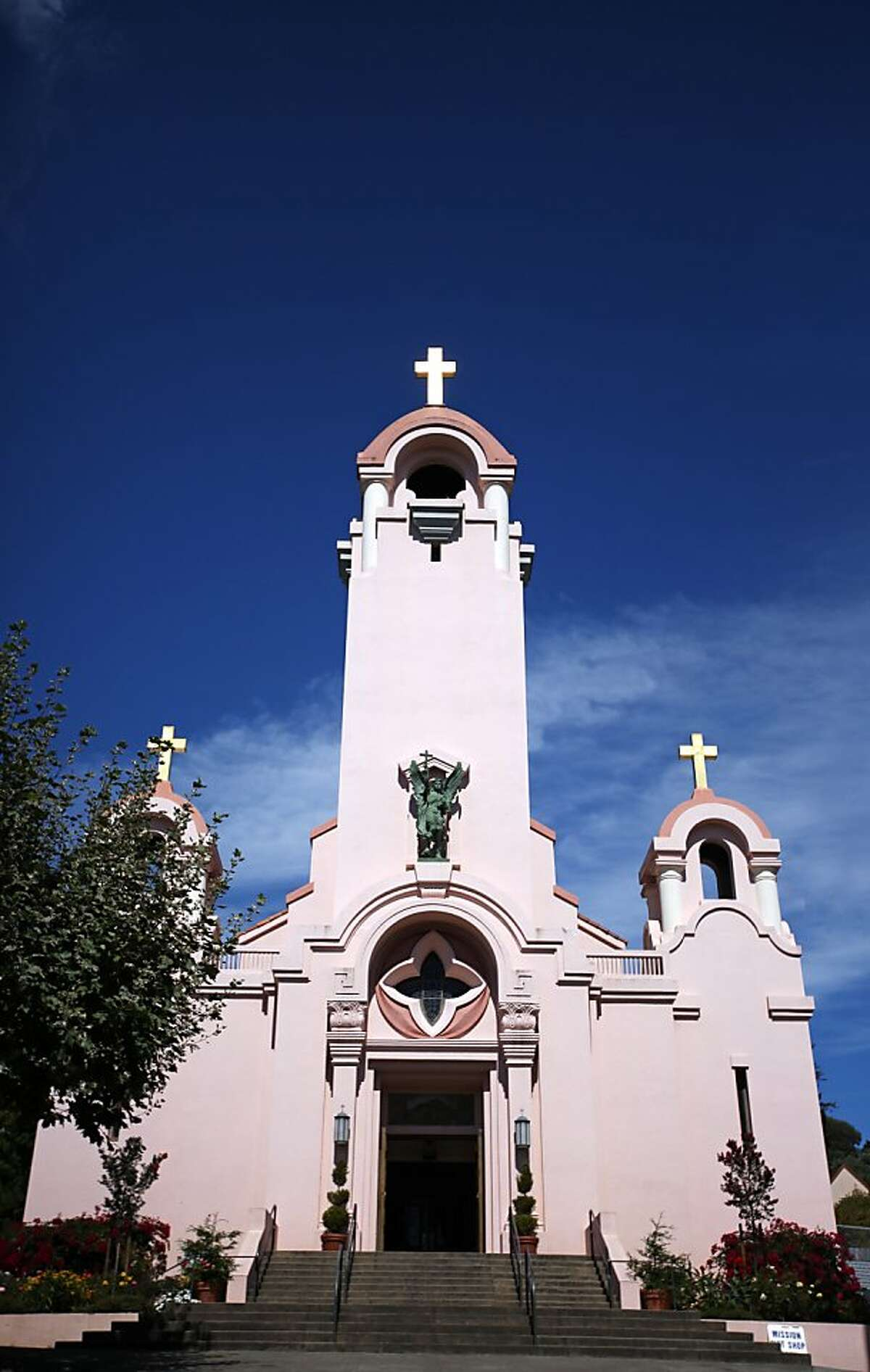 The bright afternoon sun reflects brilliantly off the cross on the highest steeple at Mission San Rafael Arcangel in San Rafael, CALIF on Sept. 24, 2011.