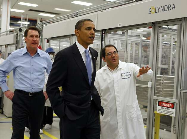 Ben Bierman (right), executive v.p. of engineering, leads President Obama on a tour of the Solyndra solar panel company in Fremont, Calif., on Wednesday, May 26, 2010. Comapny CEO Chris Gronet is seen on the left.  Ran on: 09-01-2011 President Obama tours the Solyndra factory in May 2010 with company executives Chris Gronet (left) and Ben Bierman. Ran on: 09-01-2011 President Obama tours the Solyndra factory in May 2010 with company executives Chris Gronet (left) and Ben Bierman. Photo: Paul Chinn, The Chronicle