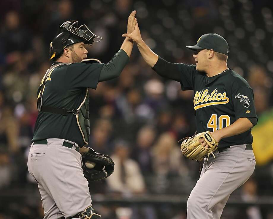 SEATTLE - SEPTEMBER 28:  Relief pitcher Andrew Bailey #40 of the Oakland Athletics is congratulated by catcher Landon Powell #11 after defeating the Seattle Mariners 2-0 at Safeco Field on September 28, 2011 in Seattle, Washington. (Photo by Otto Greule Jr/Getty Images) Photo: Otto Greule Jr, Getty Images
