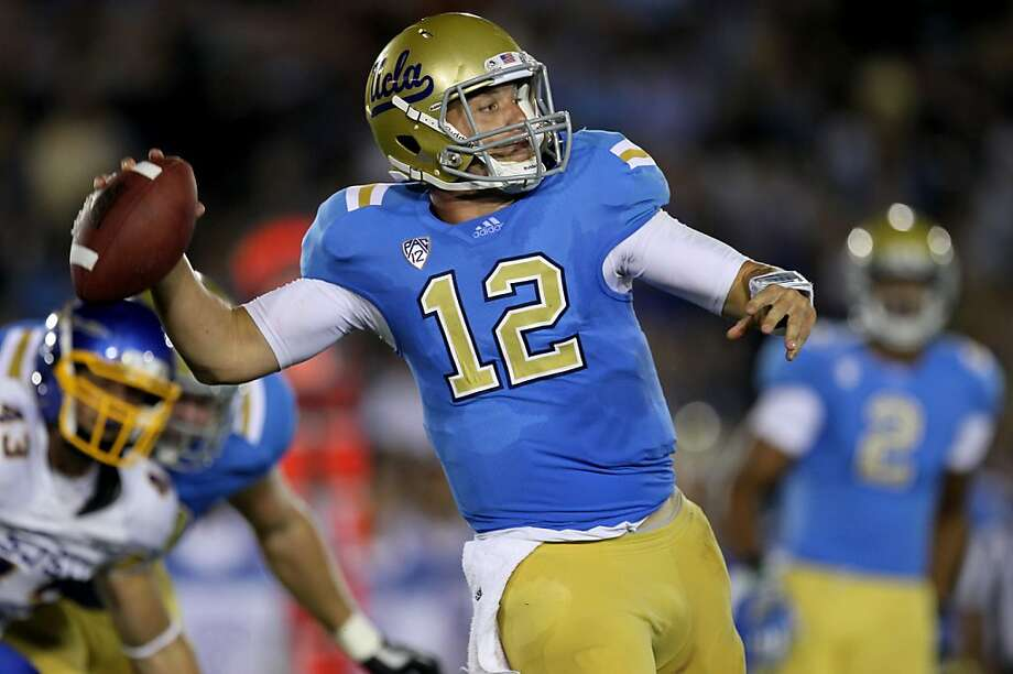 PASADENA, CA - SEPTEMBER 10:  Quarterback Richard Brehaut #12 of the UCLA Bruins throws a pass against the San Jose State Spartans at the Rose Bowl on September 10, 2011 in Pasadena, California.  UCLA won 27-17. (Photo by Stephen Dunn/Getty Images) Photo: Stephen Dunn, Getty Images
